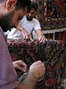 Craftsmen make carpets at a workshop in the souq, or market, of the old city in Damascus, capital of Syria. Almost anything can be bought at the souq, a traditional part of Middle Eastern cities.(Australfoto/Douglas Engle)