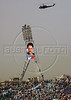 Spectators climb a light tower with a portrait of  Iranian President Mohammed Khatami, President of Iran, during an massive rally for him in Beirut, Lebanon. Khatami, the first Iranian president to visit Lebanon since the 1979 Islamic revolution,  received a hero's welcome.(Australfoto/Douglas Engle)
