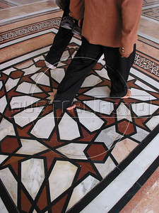 Worshippers cross a mosaic floor upon entering the Umayyad Mosque in the old city of Damascus, Syria. The mosque is one of the most important buildings of Islam, after mosques in Mecca and Medina in Saudia Arabia.(Australfoto/Douglas Engle)