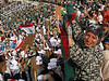 A girl holds a banner of the Hezbollah at a rally in a stadium for Iranian President Mohammed Khatami, President of Iran, during an official visit to Beirut, Lebanon. Khatami, the first Iranian president to visit Lebanon since the 1979 Islamic revolution,  received a hero's welcome.(Australfoto/Douglas Engle)