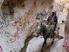 A man rides a horse through a narrow, grafitti-covered opening in the mountain in Maalula, a small town about 50 kilometers (30 miles) from Damascus, Syria.(Australfoto/Douglas Engle)