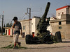 A boy walks past an aging cannon left by retreating Israeli forces in Southern Lebanon. The Hezbollah is credited with forcing the withdrawl.(Australfoto/Douglas Engle)