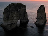 A boat motors past the Pigeon Rocks, formed by an earthquake and shaped by the sea, during sunset in Beirut, Lebanon.(Australfoto/Douglas Engle)