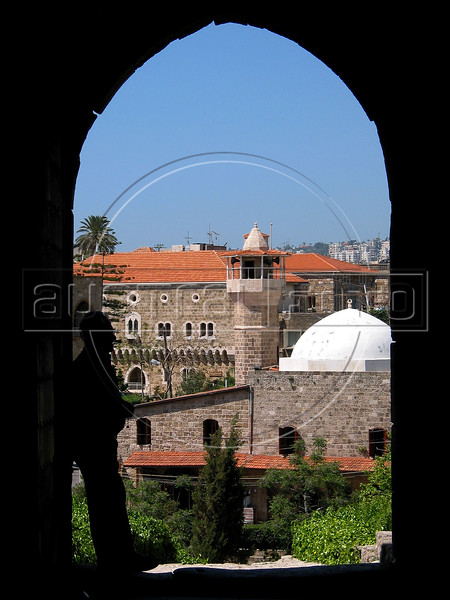 A man stands in the gateway of the Crusader Castle of Byblos, Lebanon, built in the 12th century by the Franks. The castle sits atop and was built from the ruins of the Phoenicians, the Egyptians, The Greeks, The Assyrians and the Romans. The Crusaders controlled the town from 1098 until 1266.(Australfoto/Douglas Engle)