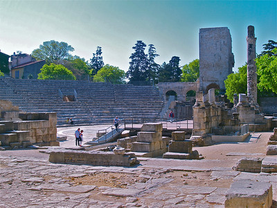Le Theatre Antique. The foundation of the Roman colony and the Roman Amphitheatre, also known as Les Arenes, where gladiators once fought in front of a crowd of 20,000 people. Arles, France.