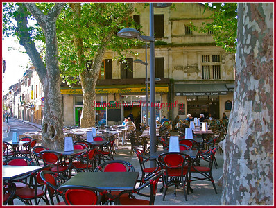 People having breakfast, on a warm sunny morning, at an outside street cafe. I was looking for Vincent.  Arles, France.