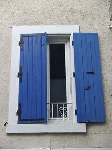 Blue shutters. Tournon, France.