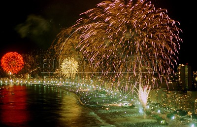 Fireworks explode over millions of people on Copacabana beach in celebration of the new year in Rio de Janeiro.AustralFoto/Douglas Engle)