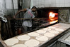 "A worker bakes Arab bread in a bakery of the ""Sahara"" neighborhood of downtown Rio de Janeiro, Brazil, Mar. 24, 2005. The neighborhood gests its name from the large the large number of Arab and Jewish merchants in the area.(AustralFoto/Douglas Engle)"