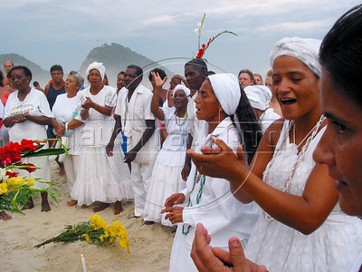 Devotees of Afro-Brazilian religions  honor  Yemanja, the Yoruba goddess of the sea on Copacabana beach in Rio de Janeiro.(AustralFoto/Douglas Engle)