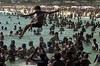 Sunbathers play in the ocean on Ipanema beach in Rio de Janeiro.(AustralFoto/Douglas Engle)