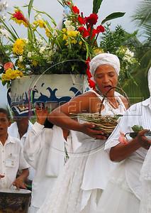 Woman walk in a procession to honor sea goddess Yemanja, the Yoruba goddess of the sea celebrated by devotees of Afro-Brazilian religions on Copacabana beach in Rio de Janeiro.(AustralFoto/Douglas Engle)