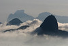 Fog rolls into Rio de Janeiro, surrounding the Sugarloaf Mountain, right.(Australfoto/Douglas Engle)