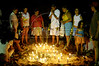 Brazilians stand around candles on Copacabana Beach as they pray to sea goddess Yemanja, the Yoruba goddess of the sea in an afro-Brazilian new year's tradition in Rio de Janeiro, Dec. 31, 2004.(AustralFoto/Douglas Engle)
