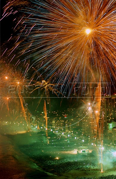 Fireworks explode over millions of people on Copacabana beach in celebration of the new year in Rio de Janeiro. (AustralFoto/Douglas Engle)