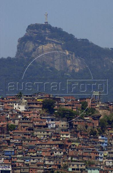 Christ the Redeemer on the Corcovado mountain rises above a favela, or slum, in Rio de Janeiro, Brazil, September 23, 2001.(AustralFoto/Douglas Engle)