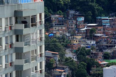 A slum is seen behind a middle-class high-rise in Copacabana in Rio de Janeiro. (Australfoto/Douglas Engle)