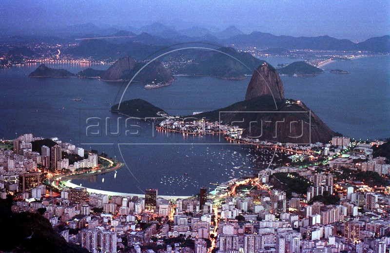Botafogo Bay and Sugarloaf mountain glow in the evening in Rio de Janeiro.(AustralFoto/Douglas Engle)
