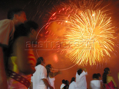 People watch fireworks explode on Copacabana Beach in Rio de Janeiro as they celebrate the new year of 2004.(AustralFoto/Douglas Engle)