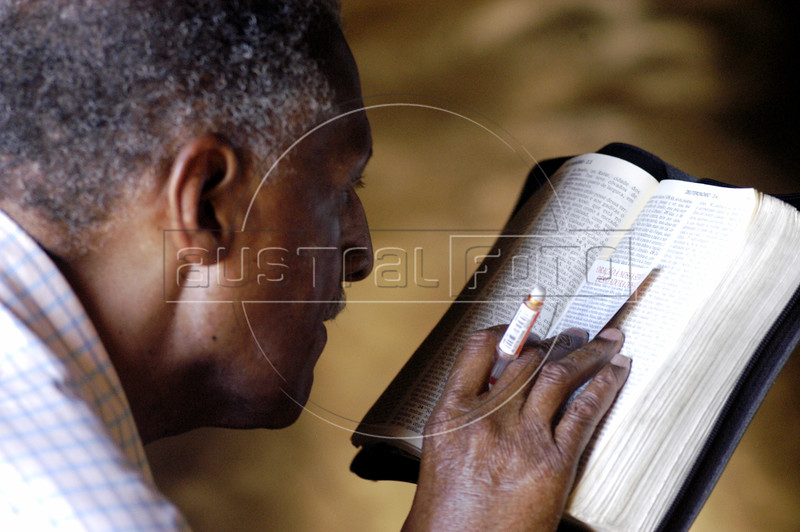 Elpidio dos Santos studies the Holy Bible in Rio de Janeiro, Saturday, April 2, 2005. Brazil is one of the largest Catholic nations of the world, with about 70 percent of the population who declares themselves Catholic. Dos Santos has studied the Bible for over 20 years and has read the entire book four times.(AustralFoto/Douglas Engle)