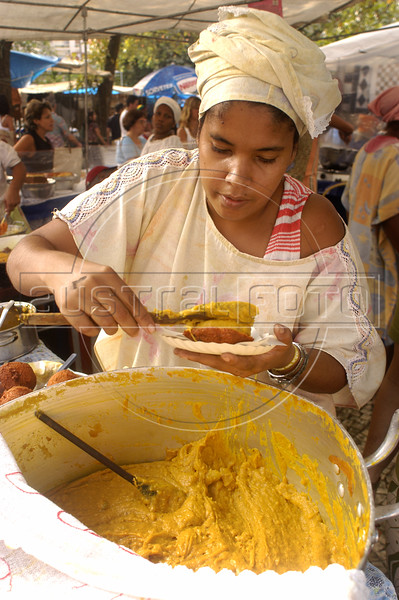 "A woman prepares ""Acaraje"" a typical food of Brazil's Bahia state, at a fair in Rio de Janeiro. (Photo/Douglas Engle) Roughy translated as a black-eyed pea fritter, acaraje is a ball of black-eyed pea meal which is deep fried in dende (palm) oil. once cooked, they are cut open and stuffed vatapa, caruru and dried shrimp. (AustralFoto/Douglas Engle)"