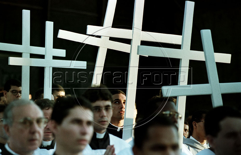 Seminarians hold crosses as they wait to begin a Good Friday procession in Rio de Janeiro, Brazil, Friday, April 2, 1999. The procession re-enacts Jesus' walk to his own crucifiction.<br /> (AustralFoto/Douglas Engle)