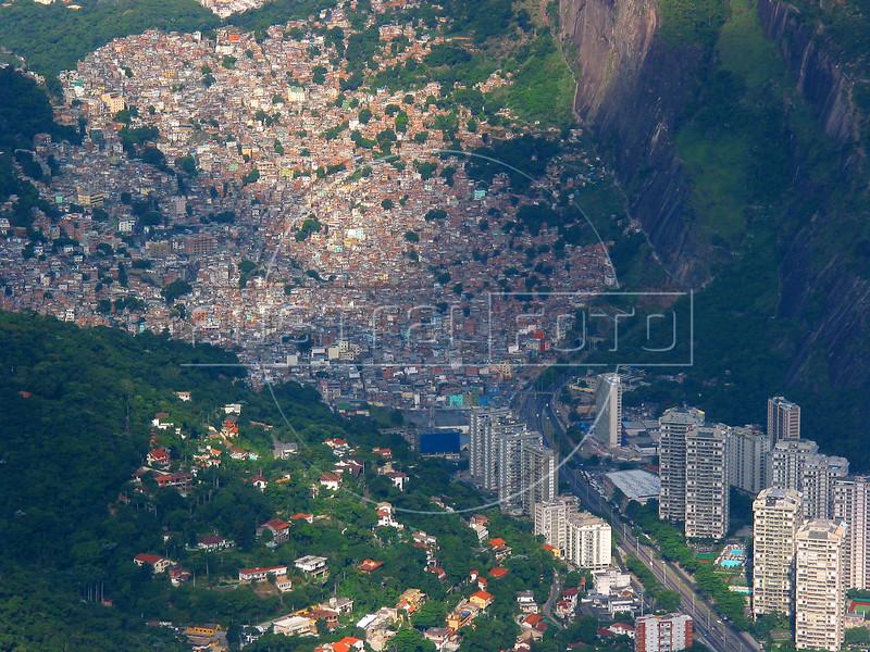 The Rocinha Slum clings to a hillside near the posh high rises of the fashionable Sao Conrado district of Rio de Janeiro.(AustralFoto/Douglas Engle)