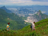 Tourists hike on top of the Pedra  da Gavea mountain, with a view of Rio de Janeiro and the Sugarloaf mountain.(AustralFoto/Douglas Engle)