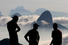 Visitors to Niteroi's Parque da Cidade watch  fog roll into Rio de Janeiro, surrounding the Sugarloaf Mountain, right.(Australfoto/Douglas Engle)