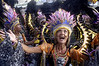 """A costumed participant parades with the Beija-Flor samba school during the """"Special Group"""" carnival parade at the sambadrome in Rio de Janeiro, Feb. 8, 2005.(AustralFoto/Douglas Engle)"""