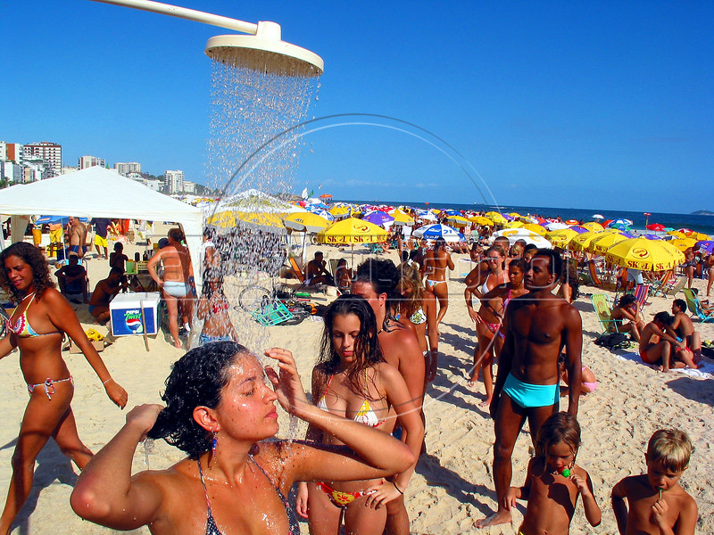 Beachgoers take a fresh water shower on Ipanema beach in Rio de Janeiro. (AustralFoto/Douglas Engle)