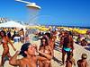 Beachgoers take a fresh water shower on Ipanema beach in Rio de Janeiro. (AustralFoto/Douglas Engle)