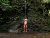 A man takes a bath in a natural shower in the Tijuca Forest in  Rio de Janeiro.(Australfoto/Douglas Engle)