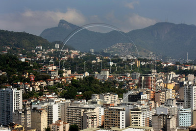 A view of downtown Rio de Janeiro, foreground, with the Santa Tereza neighborhood, middle, and the Corcovado Mountain with Christ Statue.(Photo/Douglas Engle)