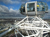 Passengers of the London Eye ferris wheel look at central London. At a height of 135 metres (443 ft), it is the biggest Ferris wheel in Europe, and has become the most popular paid tourist attraction in the United Kingdom.(Australfoto/Douglas Engle)