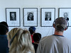 Tourists listen to audio tours as the look at photographs of prison wardens on Alcatraz Island. The small island located in the middle of San Francisco Bay served as a lighthouse, then a military fortification, then a military prison, followed by a federal prison. In 1963, it became a national recreation area. Today, the island is a historic site supervised by the National Park Service .(Australfoto/Douglas Engle)