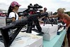 Clients look at air-powered guns on sale at a flea market in Fletcher, North Carolina. While there are laws on the sale of firearms in the USA, air-powered guns have no restrictions.(Australfoto/Douglas Engle)