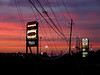 Dusk behing power lines and shopping center signs in northern Houston, Texas, USA.(Australfoto/Douglas Engle)