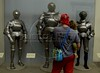 Visitors look at medieval armor on display at the Metropolitan Museum of Art in Manhattan, New York City. Approximately two million works of art are in the two million square foot (185806.08 square meter) museum, founded in 1870.(Australfoto/Douglas Engle)