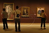 Visitors look at art in the Metropolitan Museum of Art in Manhattan, New York City. Approximately two million works of art are in the two million square foot (185806.08 square meter) museum, founded in 1870.(Australfoto/Douglas Engle)