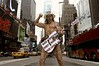 Robert John Burck, the Naked Cowboy, poses in Times Square in Manhattan, New York City. Burck, a native of Ohio, has become a fixture of Times square, playing and posing in his underwear, hat and boots for passing tourists. After a failing as a country singer in Nashville and an actor in Hollywood, Burck moved to New York with his gimmick which earns him up to 1000 dollars per day. (Australfoto/Douglas Engle)