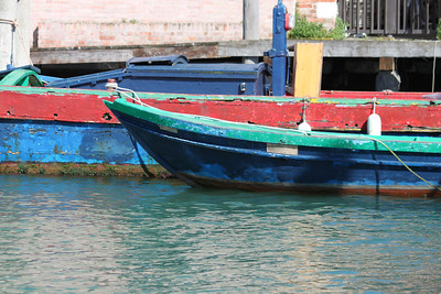 Brightly colored boats on the canal. Venice, Italy.