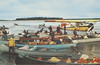 "Postcard: ""Moosonee - the dock at low tide. Native guides with freighter canoes transport passengers to Moose Factory, and points on James Bay.""<br /> Beaver aircraft in background.<br /> Published by Duke's Camera Centre, Kirkland Lake, Ontario. Photographer not stated."