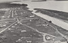 Postcard, Moose Factory, aerial looking from riverside HBC store down river. J. Sproat photo