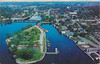 Postcard: Belleville, Ontario. Aerial from south, centred on Victoria Park and Yact Club. Used. Mailed July 13, 1964. Predates Dundas Street bridge, fuel tanks in lower right along shoreline.