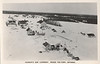Postcard: Hudson's Bay Company, Moose Factory, Ontario. Aerial view showing manager's house, staff, house, store, boats in winter storage, church, view from down river.