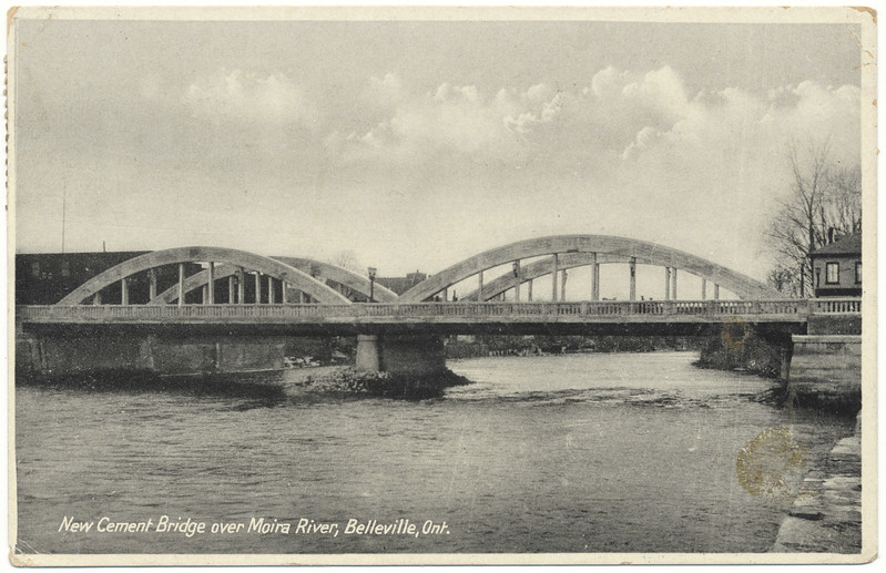 Postcard: Belleville, Ontario. New Concrete Bridge. Bridge Street bridge. Mailed 1935 April 7th. Two different King George V one cent stamps. Stain in lower right.