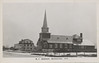 """Postcard: R.C. Mission, Moosonee, Ontario. Reverse """"Greetings from Kelly Chamandy, Moosonee, Ontario.<br /> Picture of Christ the King Catholic Cathedral and hospital. Picture predates rectory building."""
