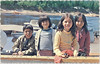 Descreened scan of Duke postcard of four Moose Factory children