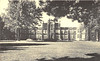 "Postcard. Compliments of Richard Ellis Printing. Belleville the Friendly City. Captioned ""Albert College"" but actually School for the Deaf. Unused"
